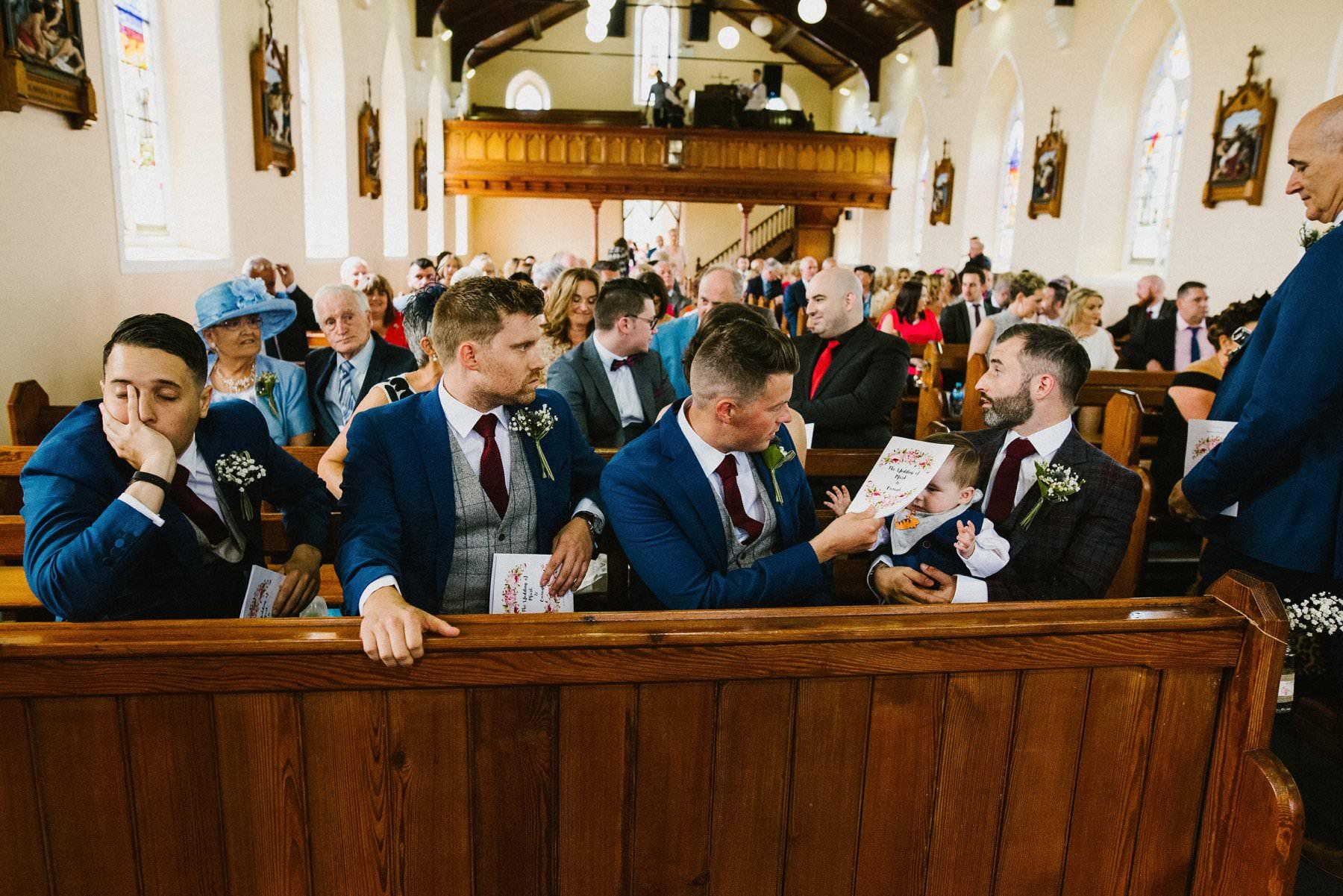 bored groomsmen documentary wedding photography
