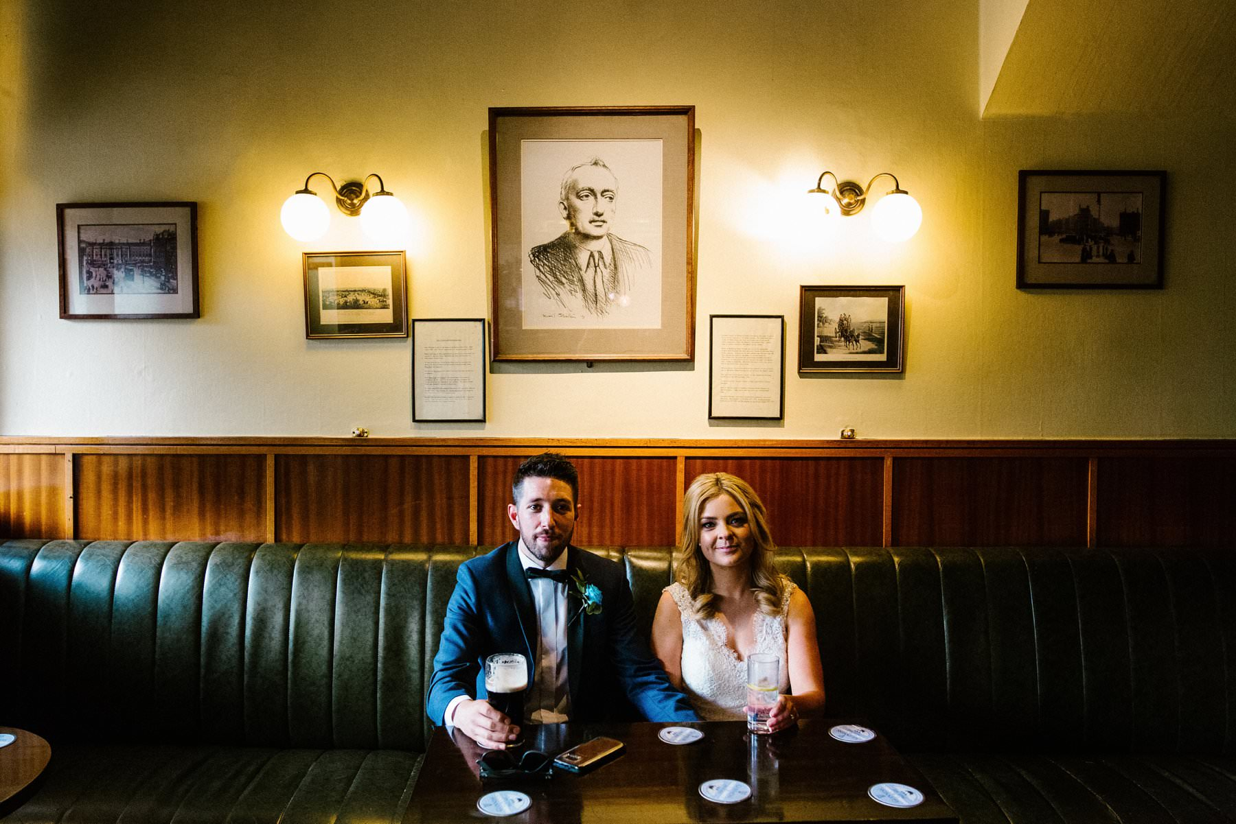 bride and groom in a pub in dublin ireland by wedding photographer Honey and the Moon Photography
