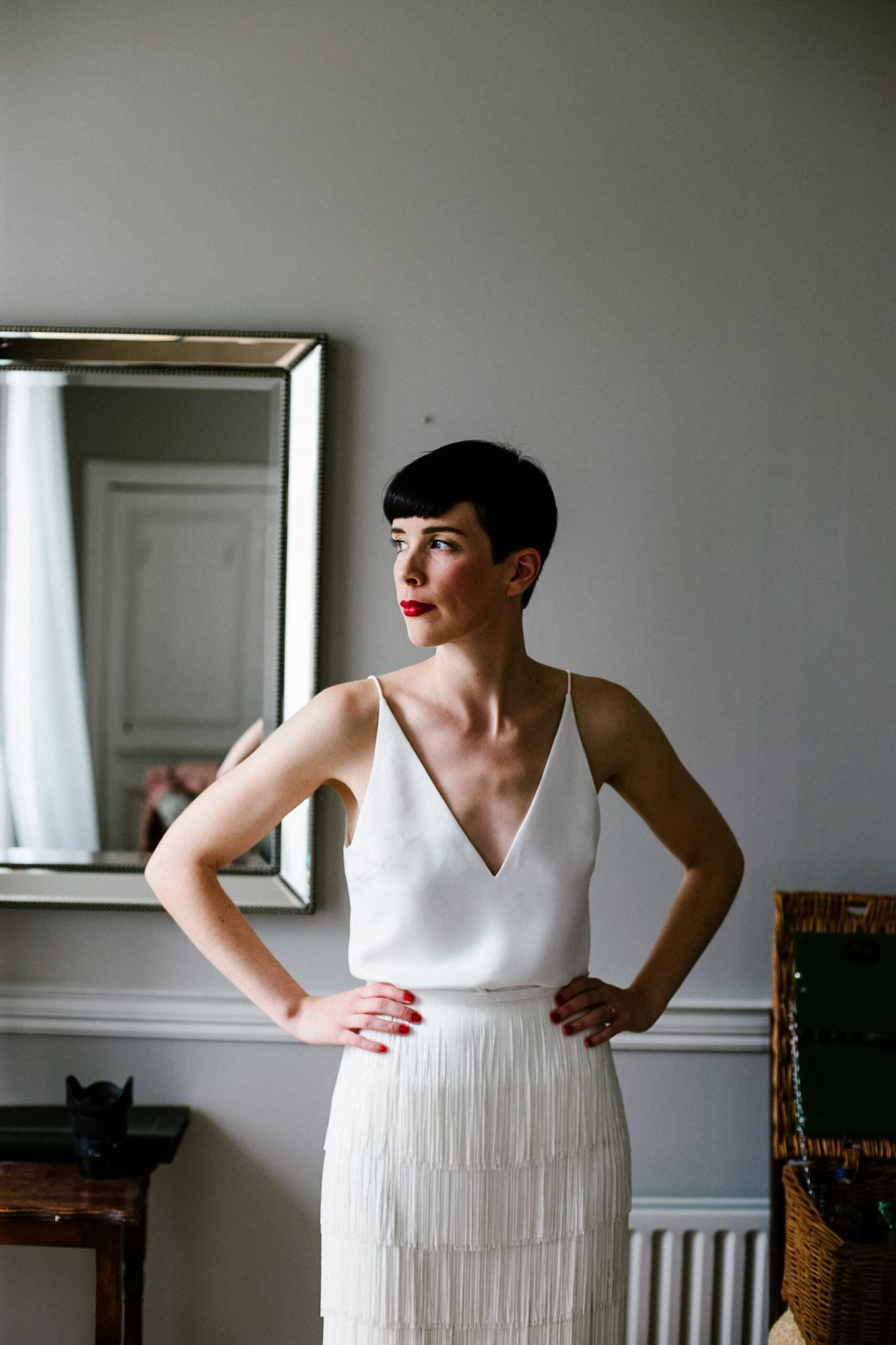 bride with short pixie hair getting ready for her wedding at Cloughjordan House, Ireland.