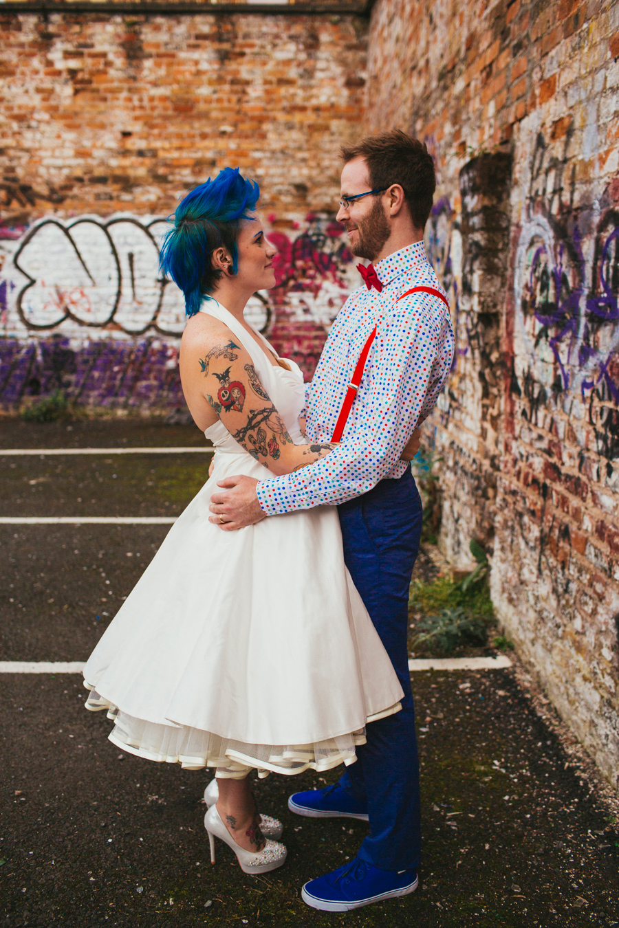 Alternative Wedding Photographer Northern Ireland, bride with blue mohawk and nightmare before Christmas tattoo, groom with beard