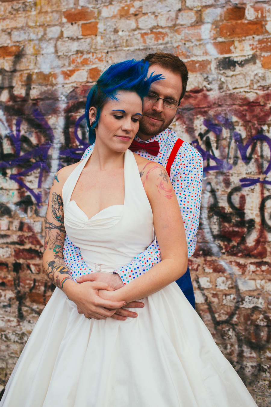Alternative Wedding Photographer Northern Ireland, bride with blue mohawk, groom with beard and glasses, bride with tattoos and septum piercing, Belfast, Northern Ireland