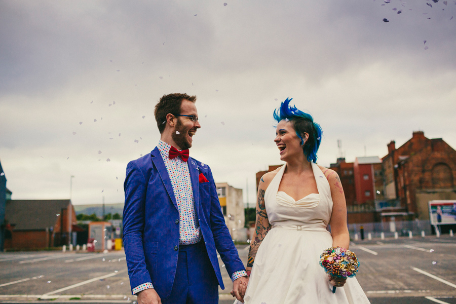 Alternative Wedding Photographer Northern Ireland, bride and groom laughing with confetti, car park wedding portraits, Smithfield and Union Quarter, Belfast