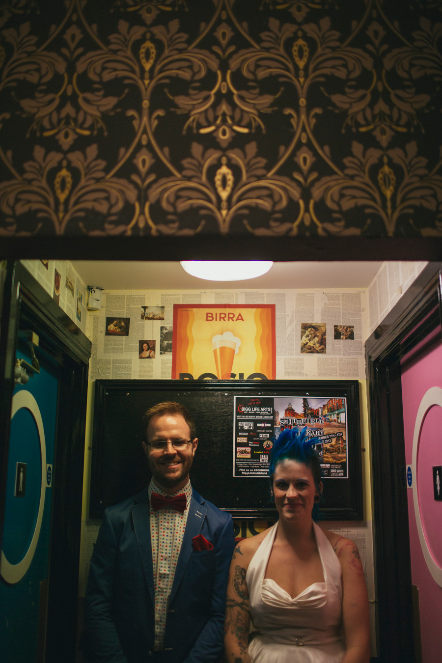 Alternative Wedding Photographer Northern Ireland, funny bride and groom outside toilets, pink and blue doors in the Hudson Bar, Belfast