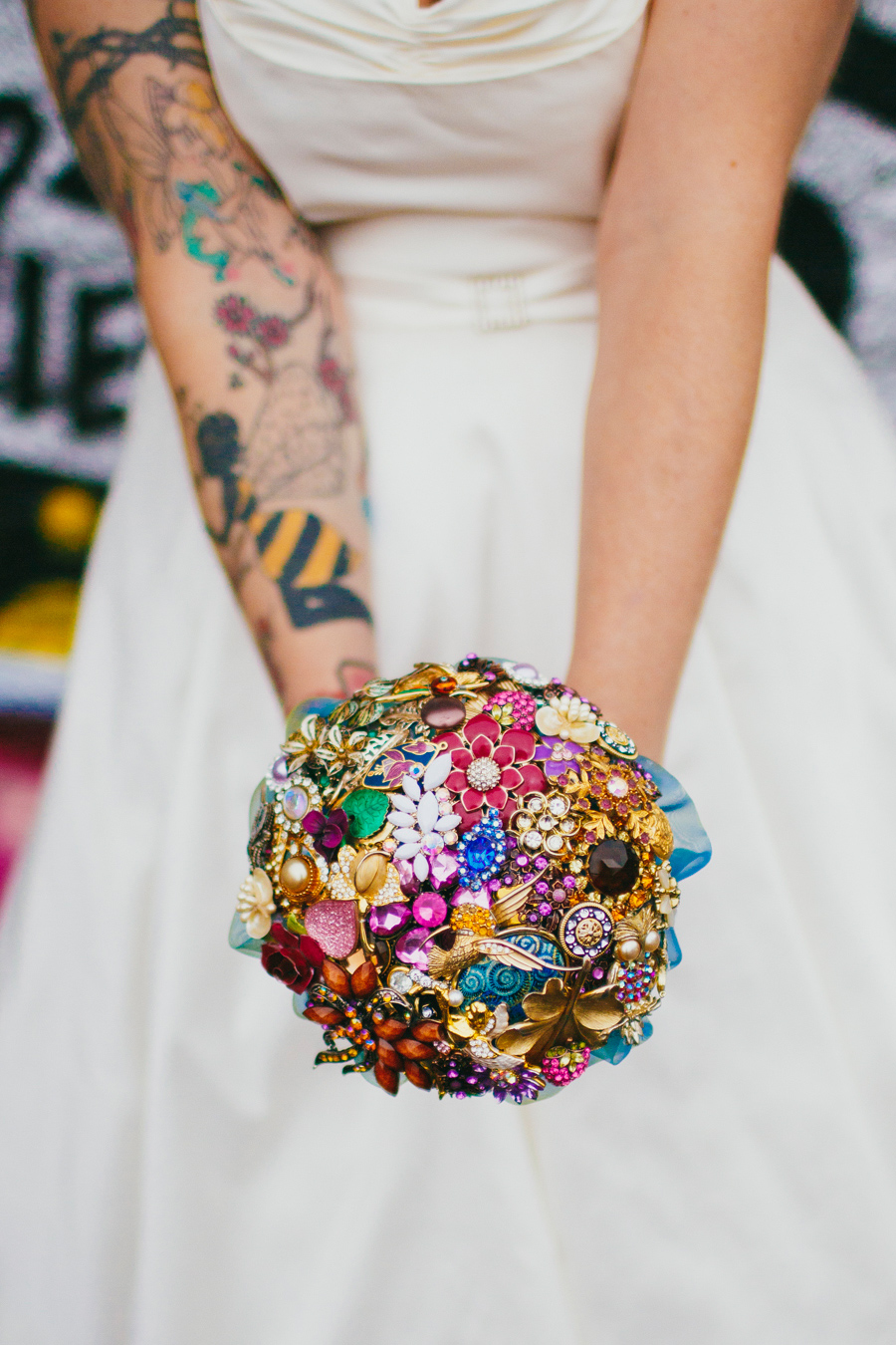 Alternative Wedding Photographer Northern Ireland, tattoo bride with brooch bouquet by aurora, tattoo sleeve, swallow brooch