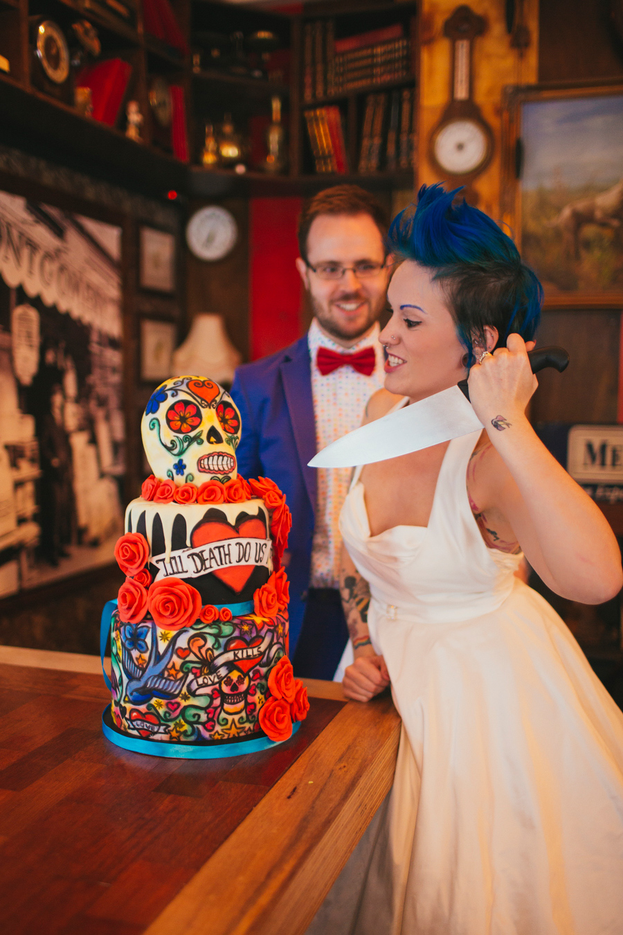 Alternative Wedding Photographer Northern Ireland, alt bride attacks cake with knife, inside heel bar, the hudson, belfast