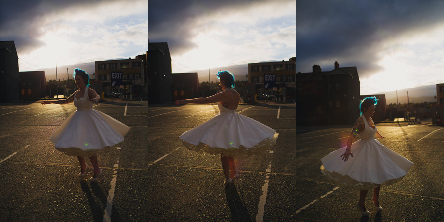 Alternative Wedding Photographer Northern Ireland, rockstar bride twirling her wedding dress by Lizzie Agnew in the sun, Smithfield and Union Quarter, Belfast, Antrim