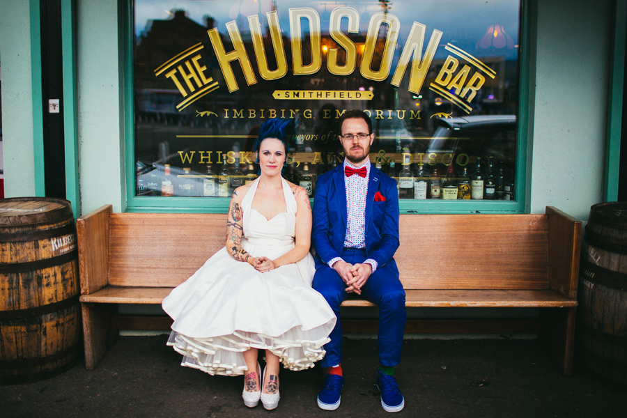 Alternative Wedding Photographer Northern Ireland, bride with tattoo and blue mohawk wearing Lizzie Agnew wedding dress, groom wearing blue suit and polka dot shirt by Focus NI, the Hudson Bar, Smithfield and Union Quarter, Belfast