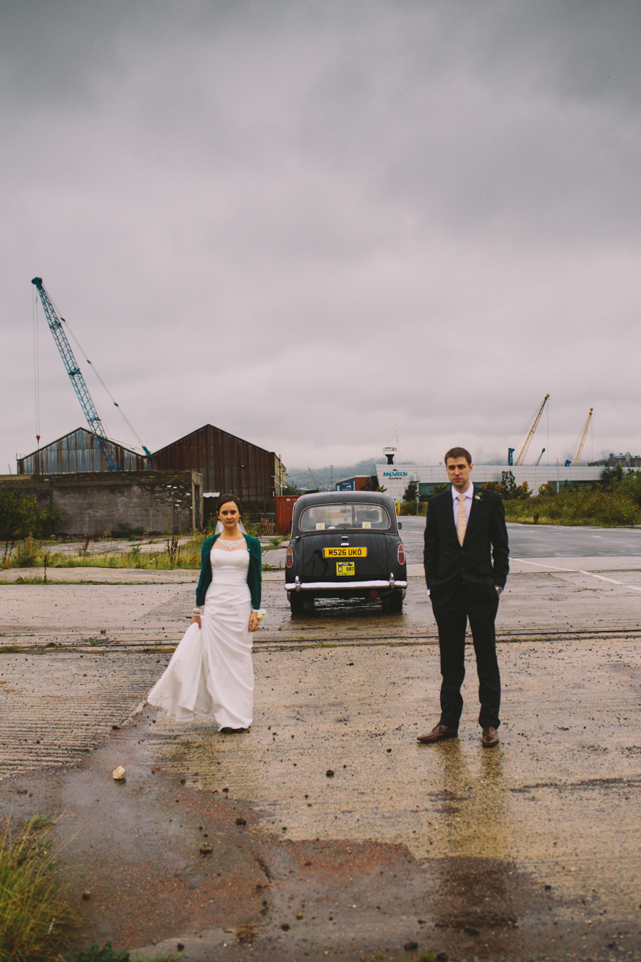 Alternative Wedding Photographer Northern Ireland, bride and groom with Black Taxi cab, Titanic Quarter, Belfast