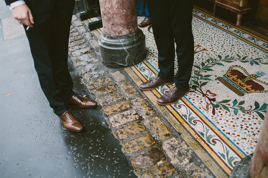 Alternative Wedding Photographer Northern Ireland, groom and best man feet outside Crown Bar, Belfast