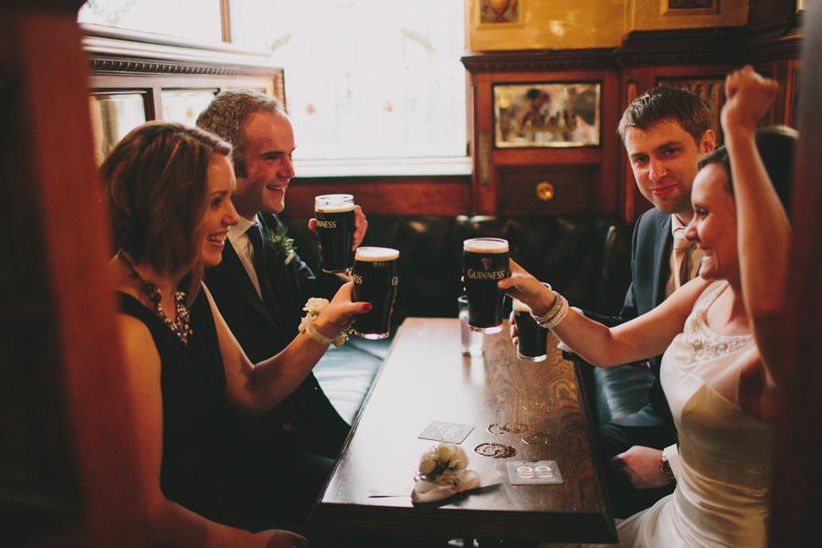 Wedding Photography Northern Ireland, wedding party at Irish Pub, Guinness, Crown Bar, Belfast.