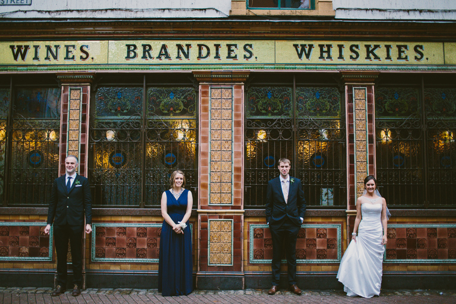 Wedding Photography Northern Ireland, wedding party ouside Irish Pub, Crown Bar, Belfast, Northern Ireland.