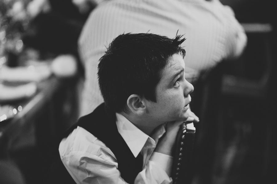 Alternative Wedding Photographer Northern Ireland, little boy engrossed in wedding speeches at wedding reception, Barking Dog, Belfast