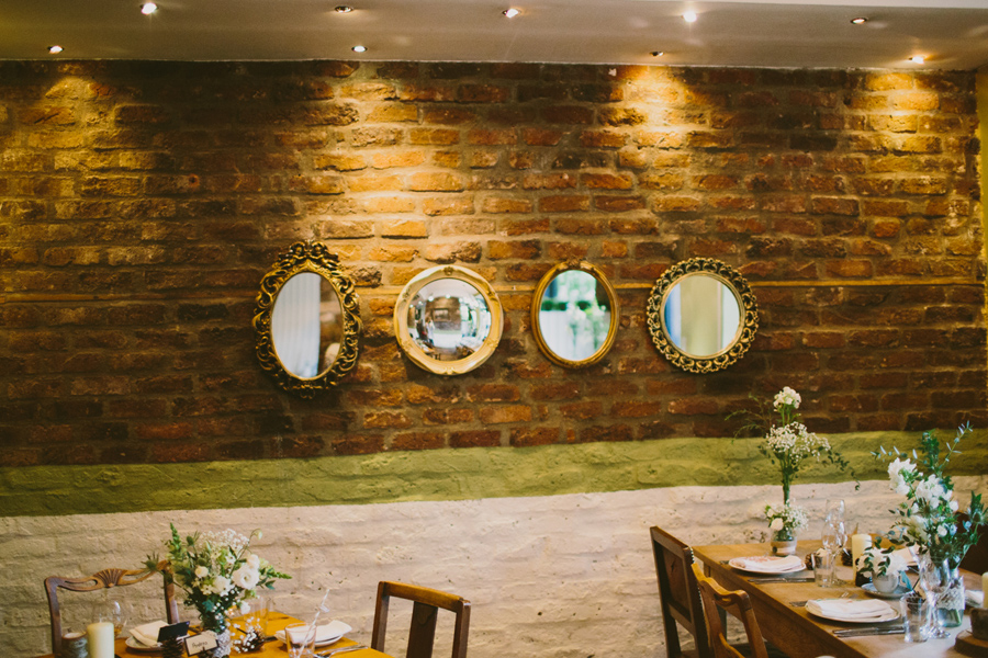 Wedding Photography Northern Ireland, mirrors on a wall at the Barking Dog Restaurant, Belfast, Northern Ireland.