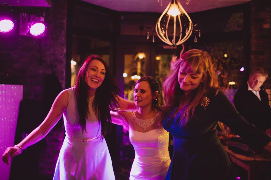 Wedding Photographer Northern Ireland, bride dancing with friends at wedding party, creepy DJ, Barking Dog, Belfast, Northern Ireland.