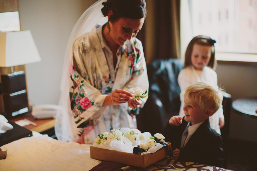 Wedding Photographer Northern Ireland, bride showing page boy flower, Europa Hotel.