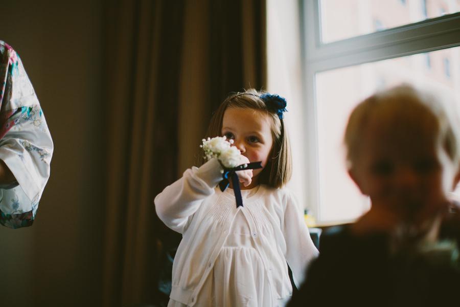 Wedding Photography Northern Ireland, adorable flower girl with corsage, Europa Hotel Northern Ireland.