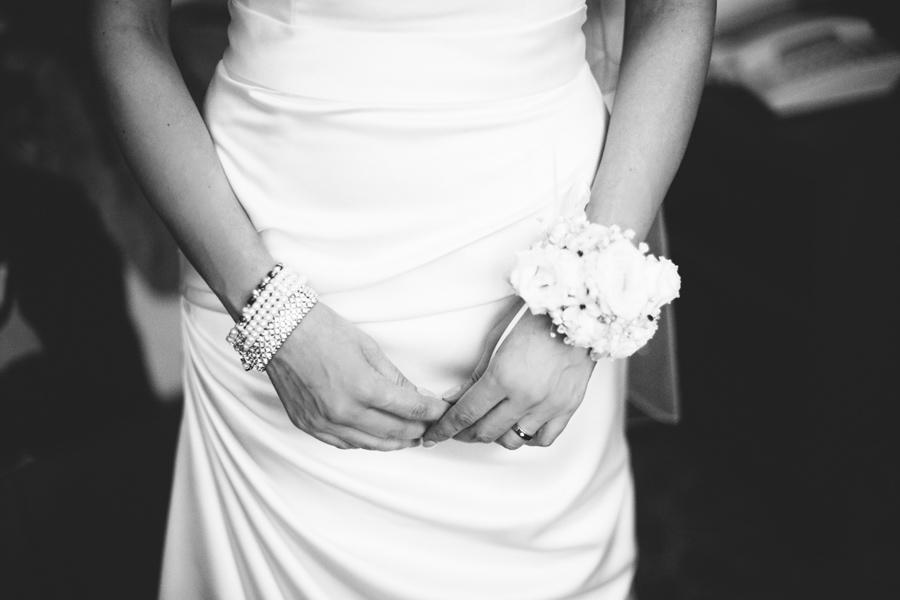 Wedding Photography Northern Ireland, bride, hands with corsage, Belfast Hotel, Northern Ireland.