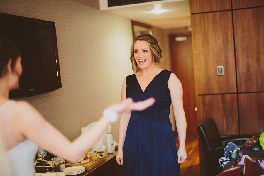 Wedding Photography Northern Ireland, excited bridesmaid in Europa Hotel, Belfast.