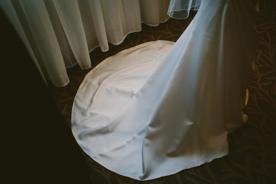 Wedding Photography Northern Ireland, brides wedding dress train, Europa Hotel, Belfast.
