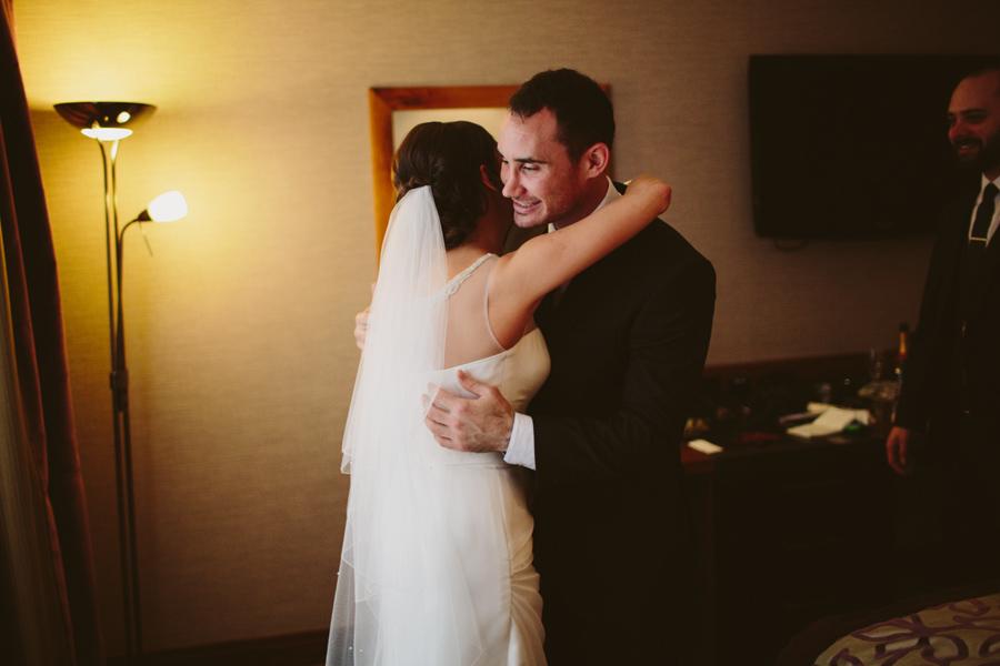 Wedding Photography Northern Ireland, brother hugs sister in wedding dress, europa hotel, belfast.