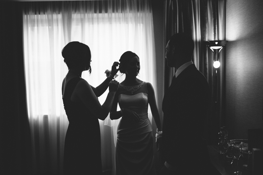 Wedding Photography Northern Ireland, bride has final touches before wedding, Europa hotel, Belfast.