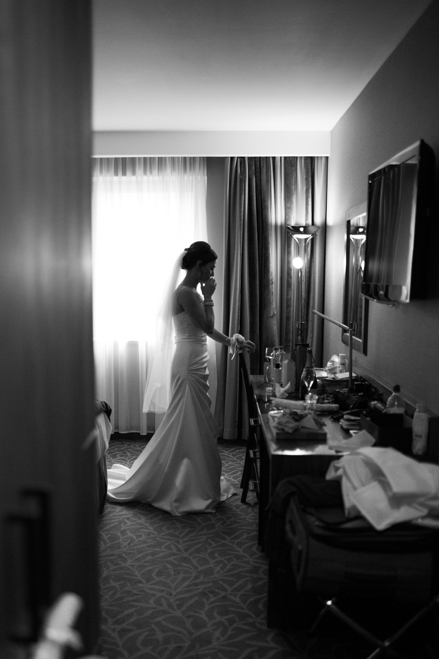 Wedding Photographer Northern Ireland, bride has a quiet moment of reflection before wedding, Europa hotel, Great Victoria Street, Belfast.