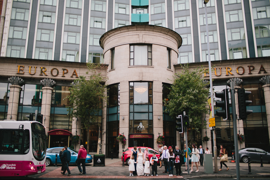 Wedding Photography Northern Ireland, bridal party outside the Europa Hotel, Belfast, Northern Ireland.