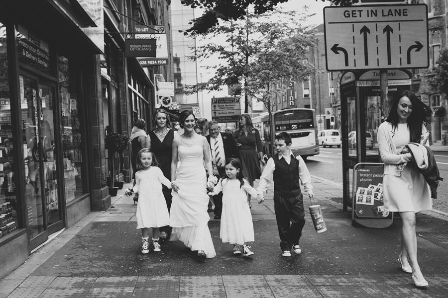 Wedding Photography Northern Ireland, bride walks through city to get married, Howard Street, Belfast, Northern Ireland.