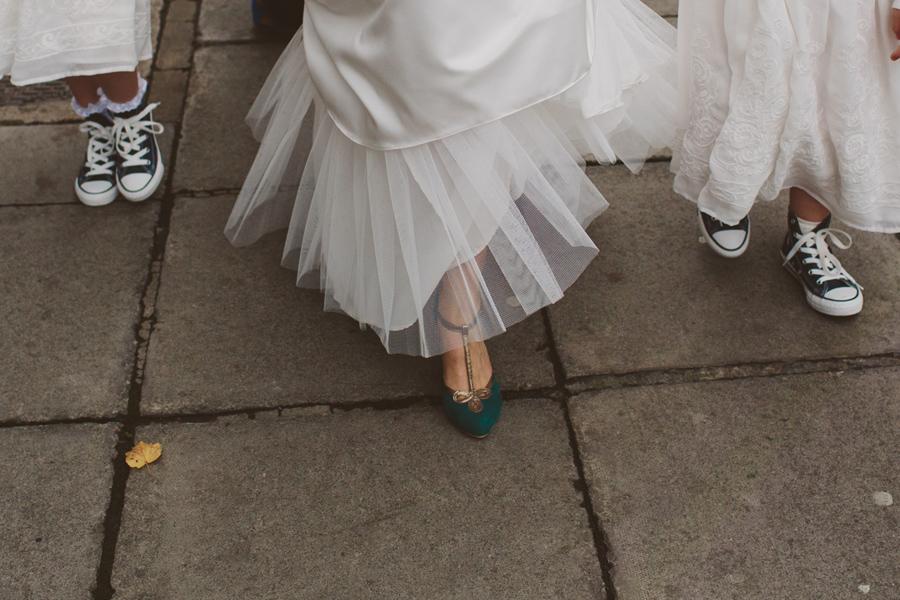 Wedding Photographer Northern Ireland, bride in teal heels, flower girls in converse. Belfast, Ireland.