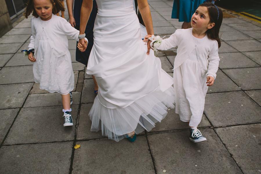 Wedding Photographer Northern Ireland, bride with flower girls, walking through city to get married, Belfast, N. Ireland.