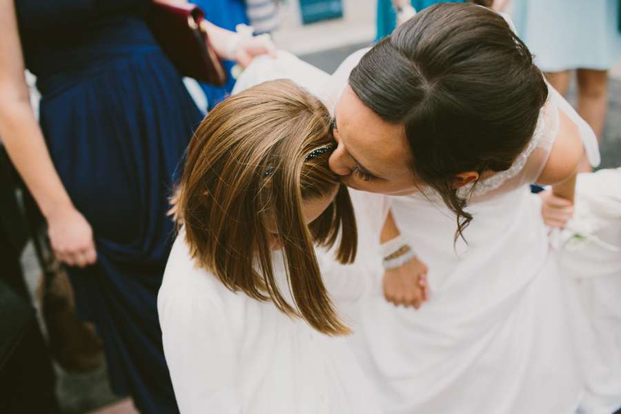 Wedding Photography Northern Ireland, bride kisses flower girl on forehead, Belfast City, N. I.