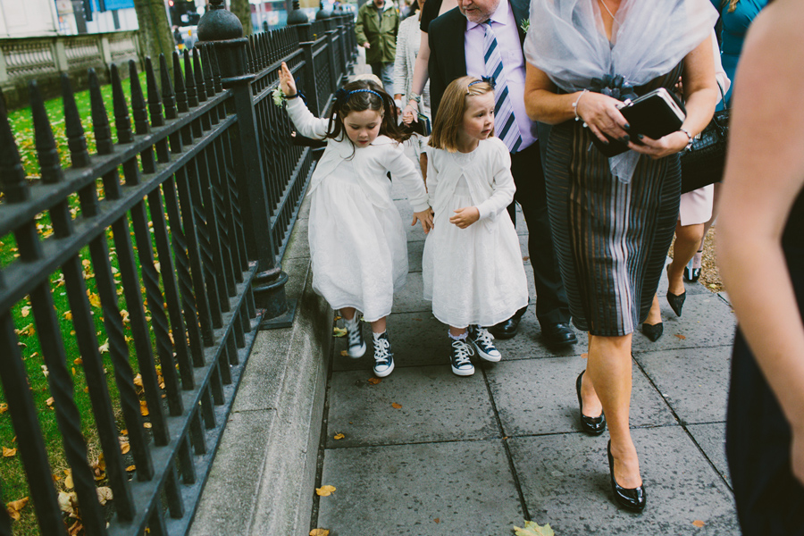 Wedding Photography Northern Ireland, flower girls playing and holding hands, Belfast City Hall, N.I,