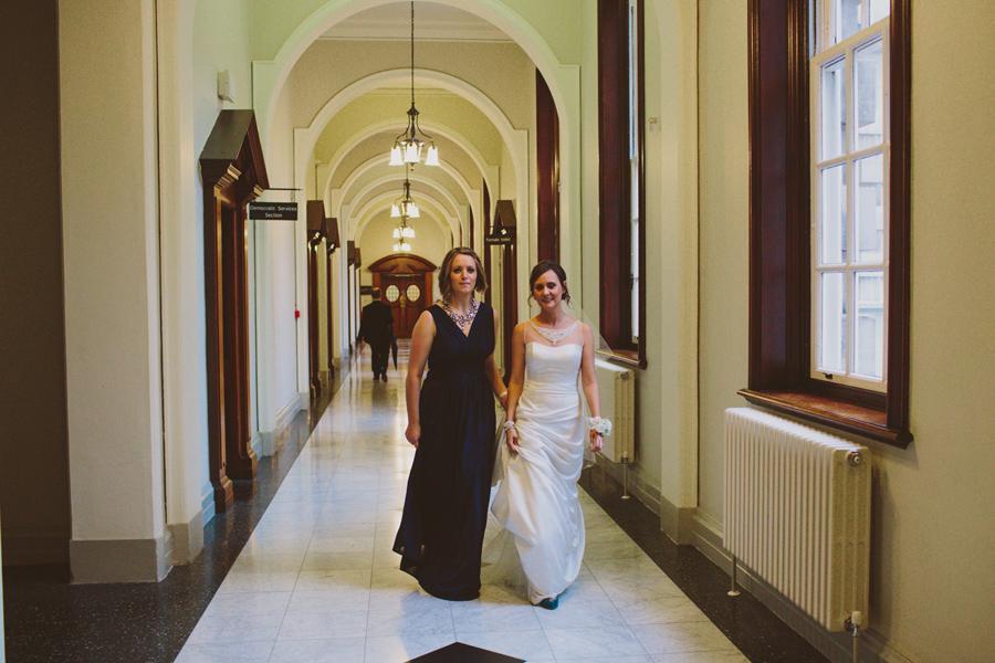 Wedding Photography Northern Ireland, bride walks though the corridor of Belfast City Hall, Northern Ireland.