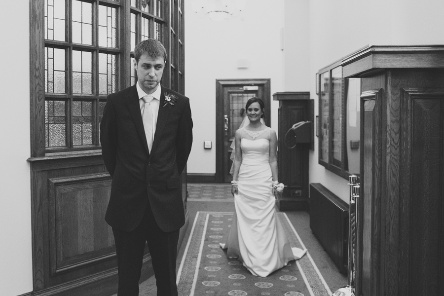 Wedding Photographer Northern Ireland, bride and groom have first look at Belfast City Hall, Northern Ireland.