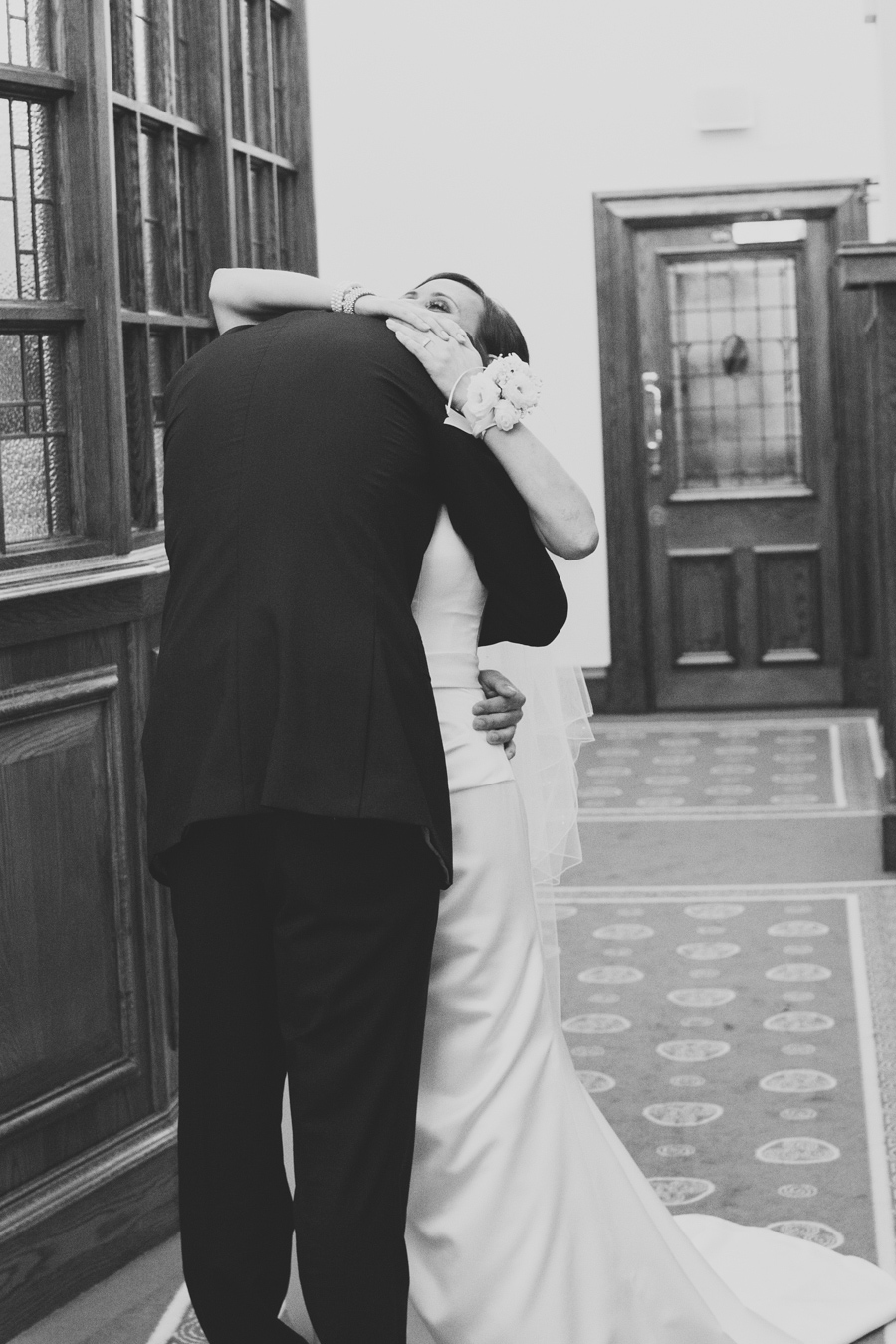 Alternative Wedding Photographer Northern Ireland, happy bride and groom to be hug during first look, Belfast City Hall.
