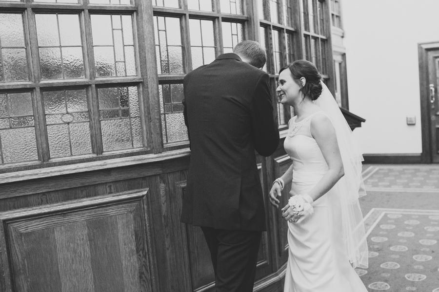 Wedding Photography Northern Ireland, groom is comforted by bride, Belfast City Hall, Northern Ireland.