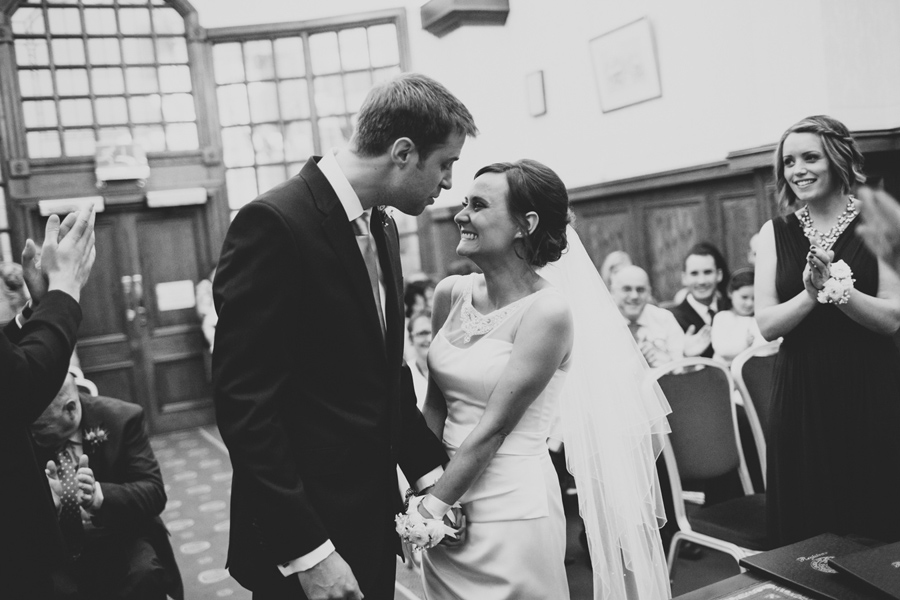 Wedding Photographer Northern Ireland, groom leans in for first kiss, City Hall Belfast.