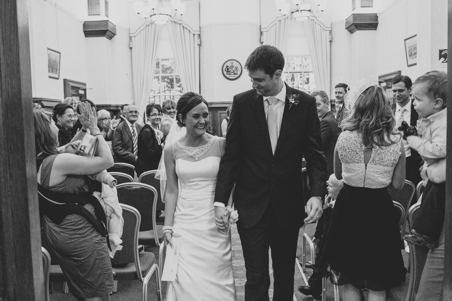 Wedding Photography Northern Ireland, happy bride and groom leave registry office, Belfast City Hall.