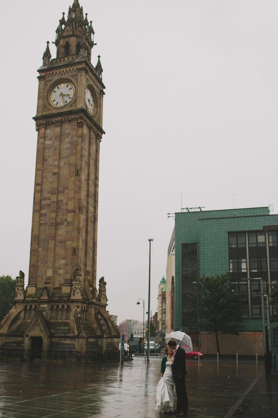 Wedding Photographey Northern Ireland, bride and groom kiss at Albert Clock, Belfast.