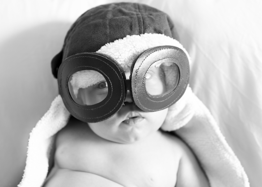 Family Photography Northern Ireland, the best baby photography ever, newborn wearing aviator hat and goggles, children's photographer Belfast.
