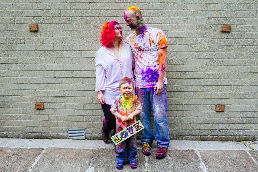 Family Photography Northern Ireland, happy family covered in colourful holi paint, Ballymoney.