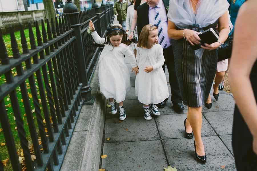 Wedding Photographer Northern Ireland, flower girls walking to wedding, Belfast City Center, County Antrim.