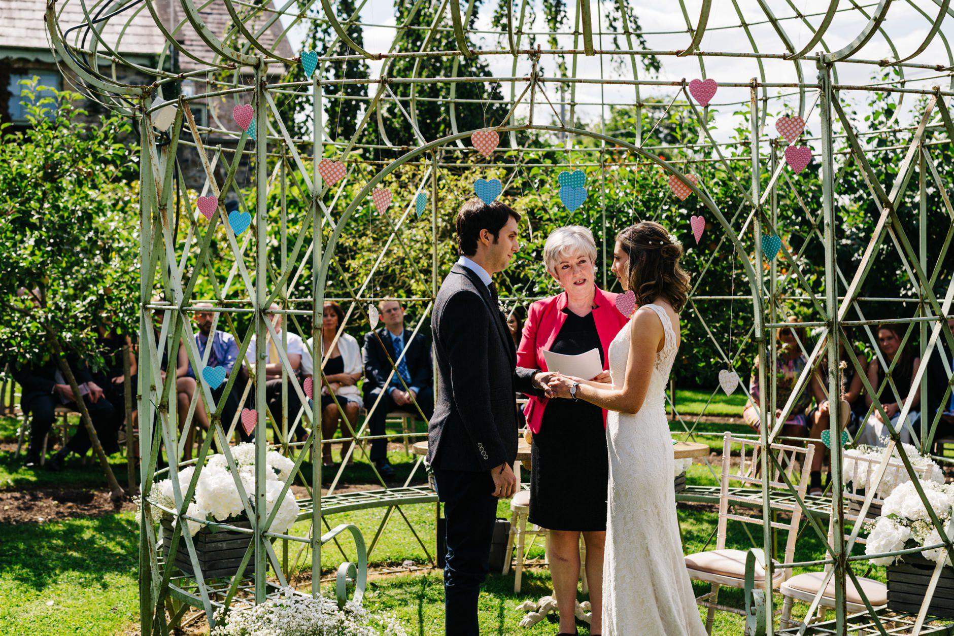 wedding photographer ireland outdoor ceremony hand binding
