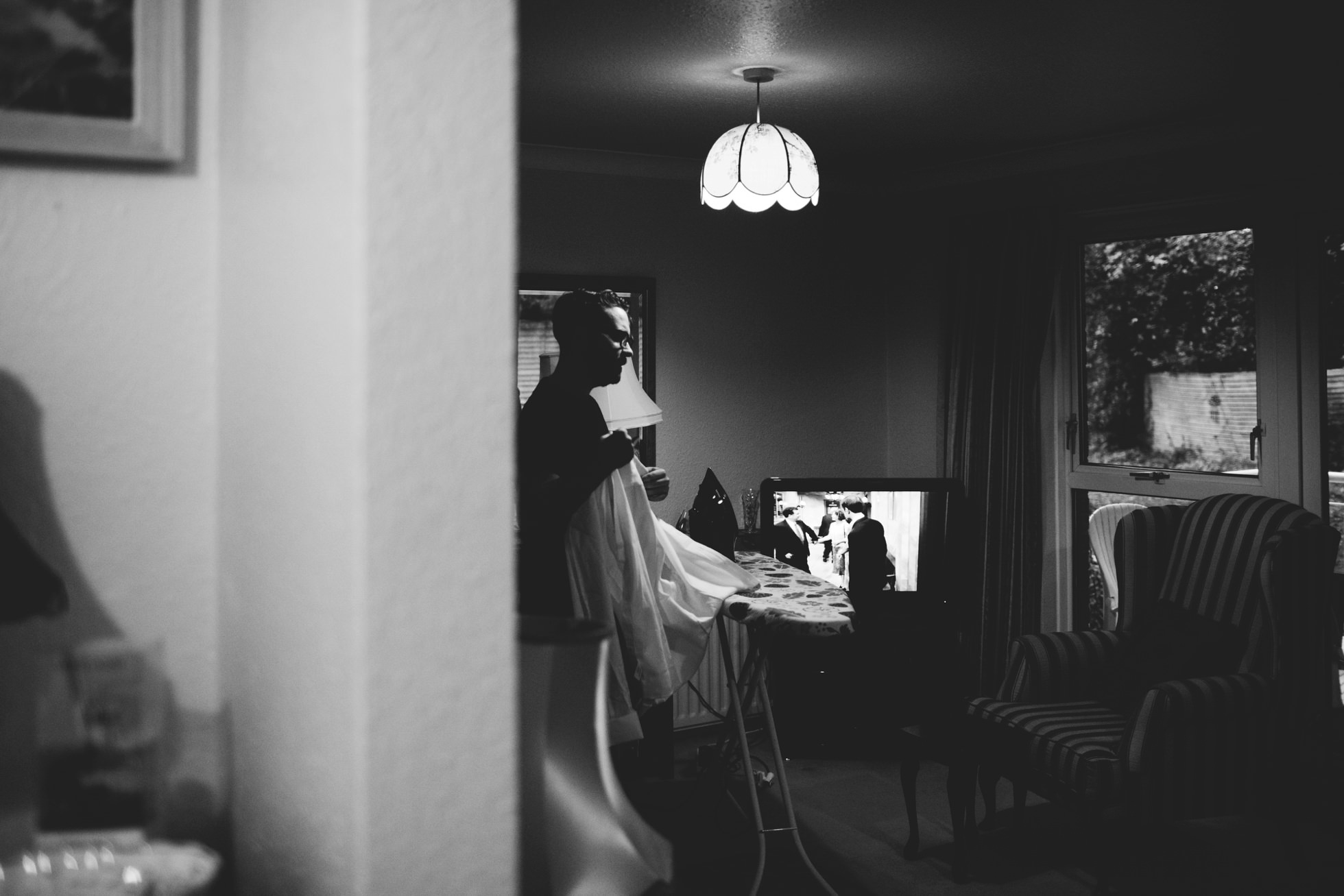 groom getting ready at his parents house wedding photography northern ireland
