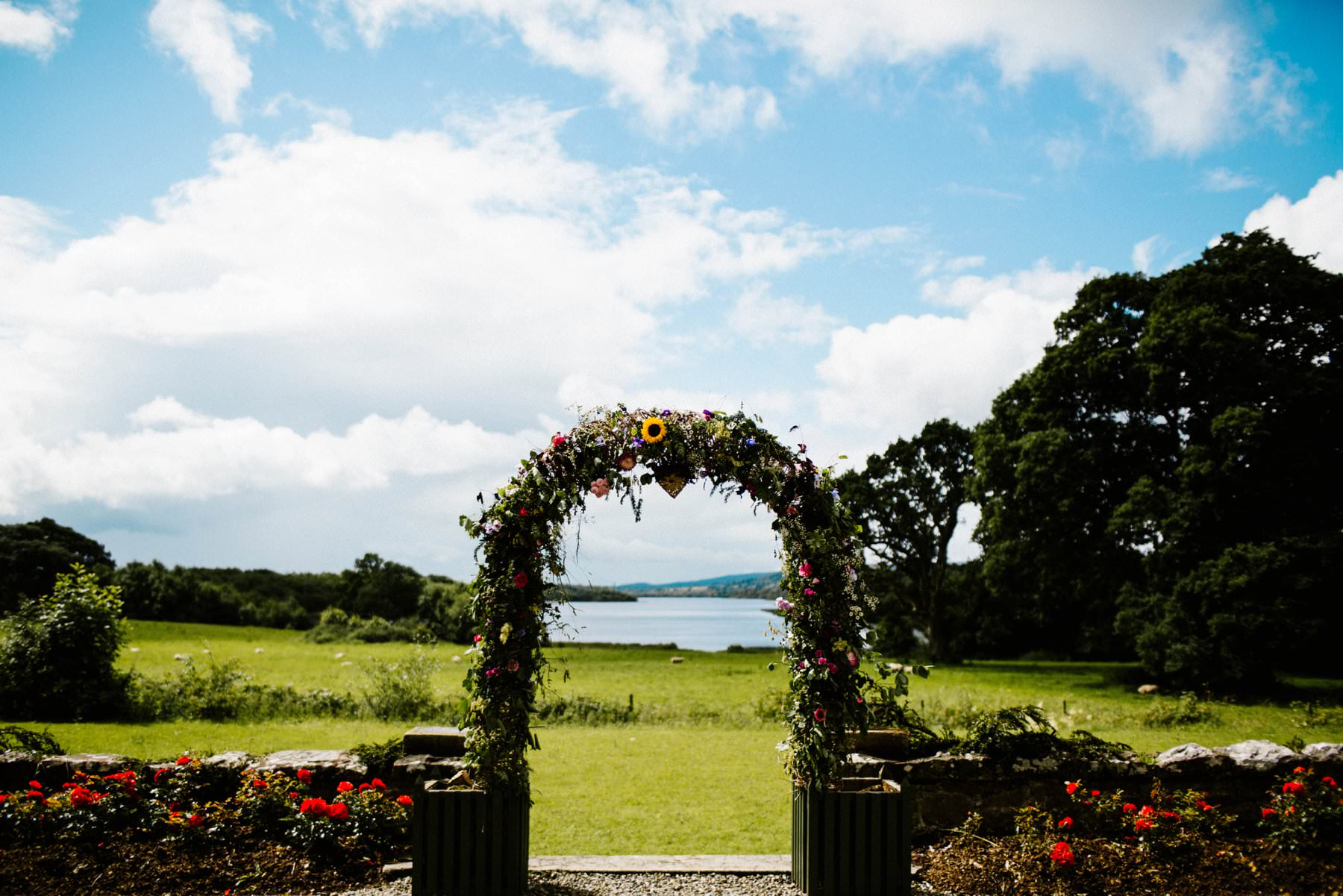 flower arch at fermanagh lakes wedding photography