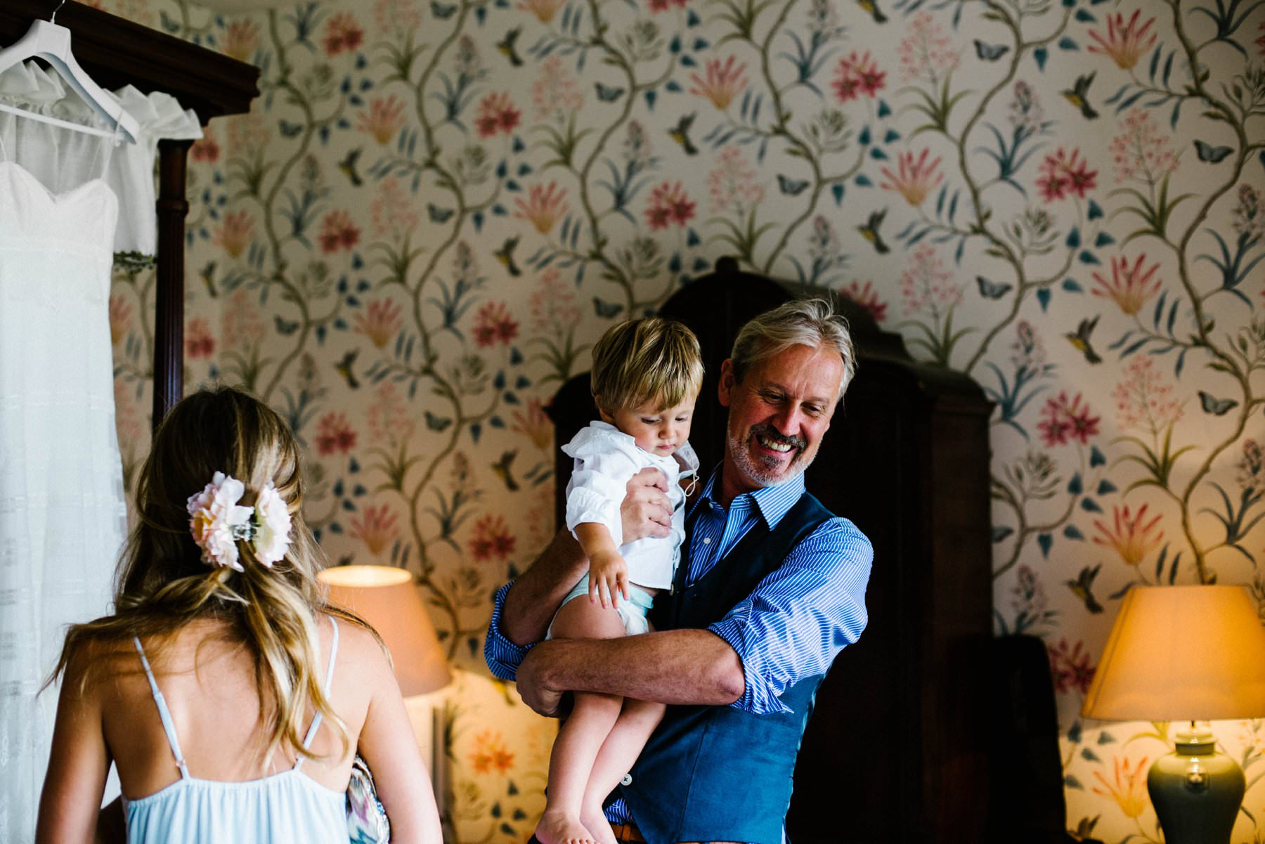 father of the bride hugs page boy wedding photography ireland