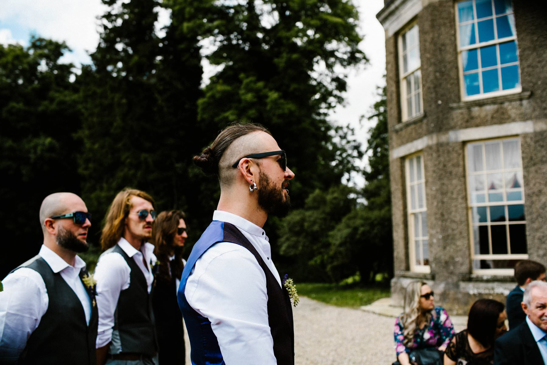 groom with top knot waits for bride wedding photography ireland