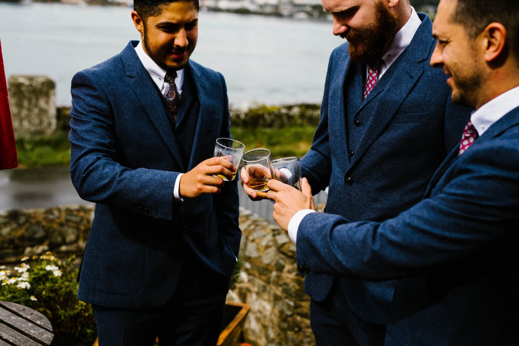 groom and groomsmen enjoying a drink wedding photography northern ireland