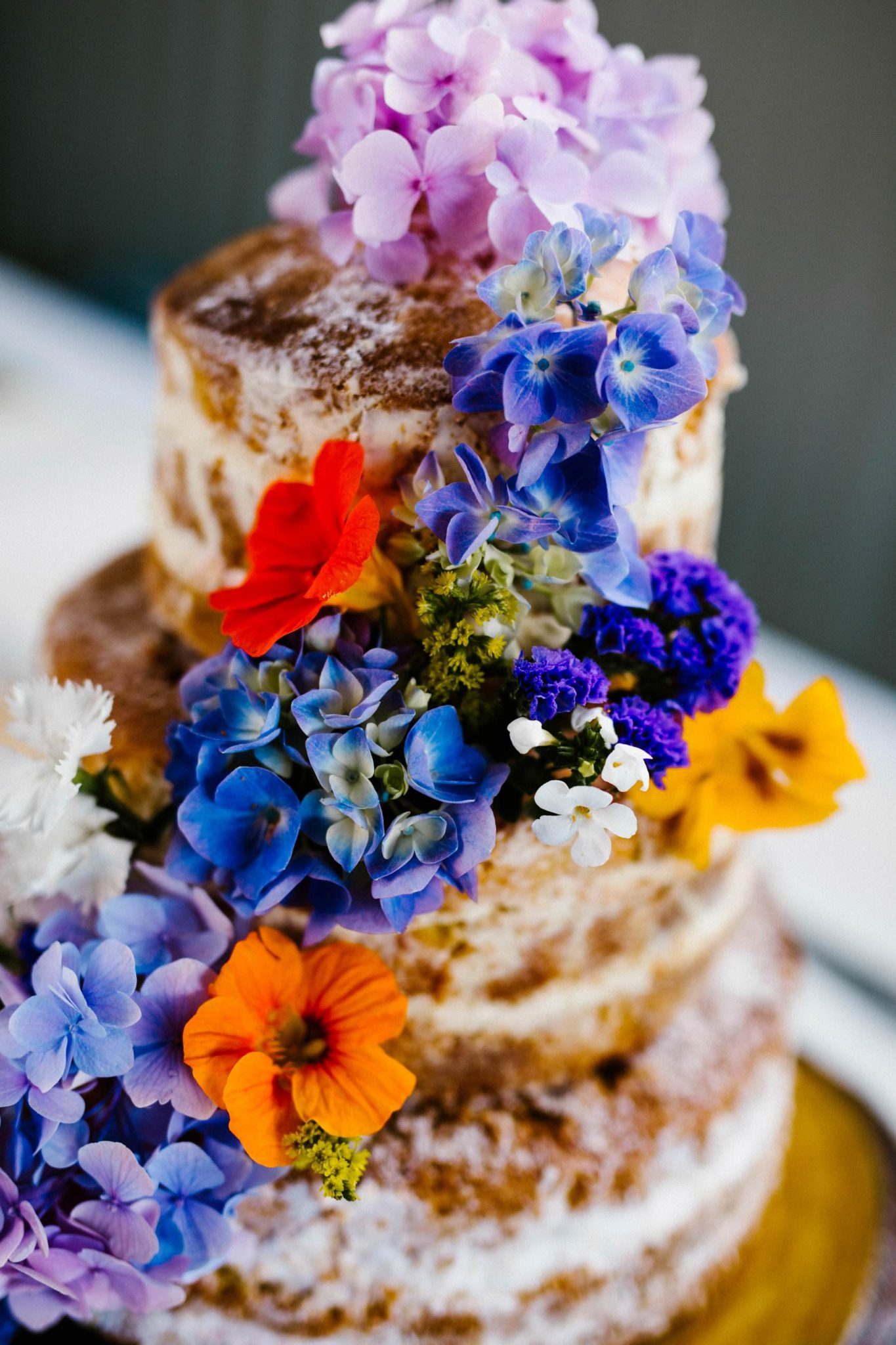 wedding cake decorated with real flowers wedding photographer northern ireland
