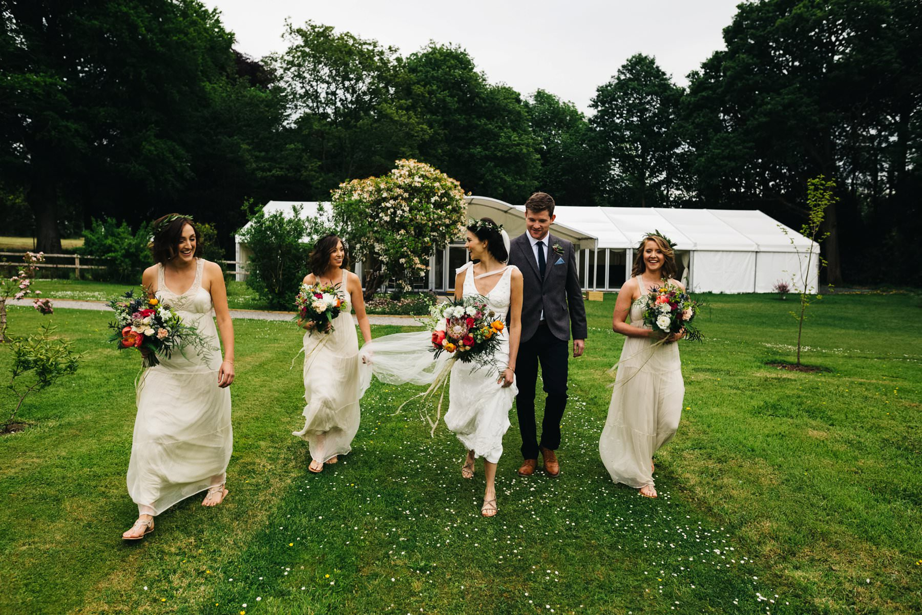 bride walking with bridesmaids wedding photography northern ireland